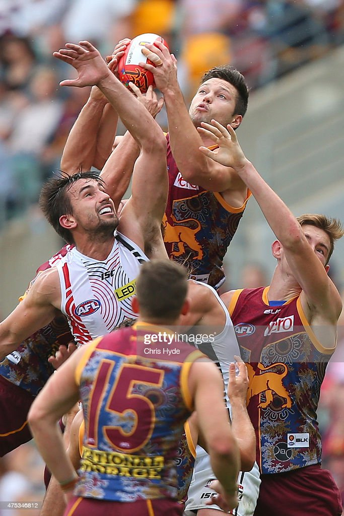 Stefan Martin of the Lions and Billy Longer of the Saints compete for the ball during the round nine AFL match between the Brisbane Lions and the St Kilda Saints at The Gabba on May 31, 2015 in Brisbane, Australia.