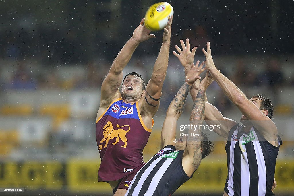 Stefan Martin of the Lions and Jamie Elliott and Travis Cloke of the Magpies contest a mark during the round one AFL match between the Brisbane Lions and Collingwood Magpies at The Gabba on April 4, 2015 in Brisbane, Australia.