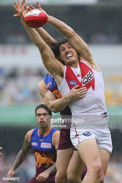 Stefan Martin of the Lions and Kurt Tippett of the Swans compete for the ball during the round six AFL match between the Brisbane Lions and the...