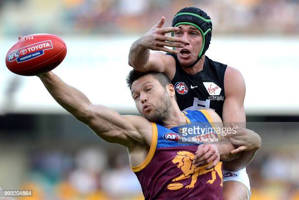 Stefan Martin of the Lions and Matthew Kreuzer of Carlton challenge for the ball during the round 16 AFL match between the Brisbane Lions and the...