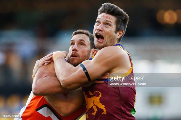 Stefan Martin of the Lions battles with Shane Mumford of the Giants during the round 14 AFL match between the Brisbane Lions and the Greater Western...