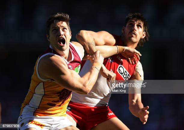 Stefan Martin of the Lions competes for the ball against Sam Naismith of the Swans during the round seven AFL match between the Sydney Swans and the...