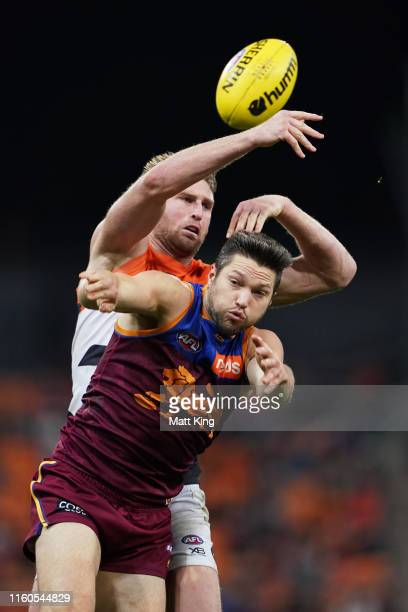 Stefan Martin of the Lions is challenged by Dawson Simpson of the Giants during the round 16 AFL match between the Greater Western Sydney Giants and...