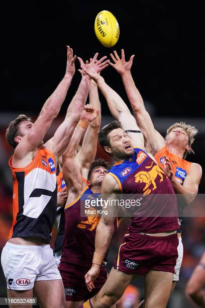 Stefan Martin of the Lions is challenged for the ball during the round 16 AFL match between the Greater Western Sydney Giants and the Brisbane Lions...