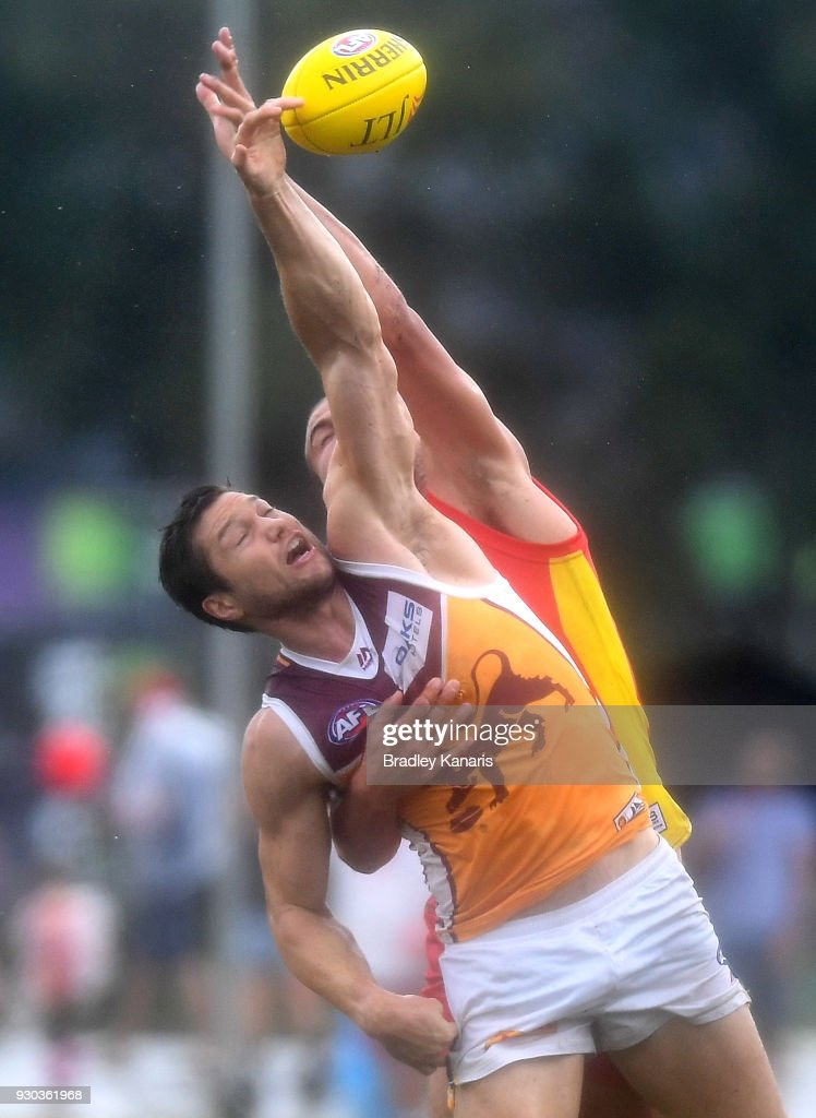 Stefan Martin of the Lions is pressured by the defence during the JLT Community Series AFL match between the Gold Coast Suns and the Brisbane Lions at Fankhauser Reserve on March 11, 2018 in Brisbane, Australia.