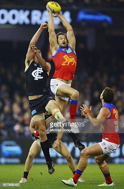 Stefan Martin of the Lions marks the ball against Matthew Kreuzer of the Blues during the round 11 AFL match between the Carlton Blues and the...