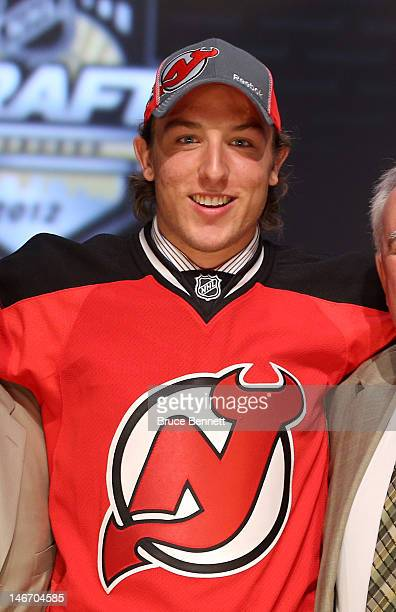 Stefan Matteau, 29th overall pick by the New Jersey Devils, poses on stage during Round One of the 2012 NHL Entry Draft at Consol Energy Center on...