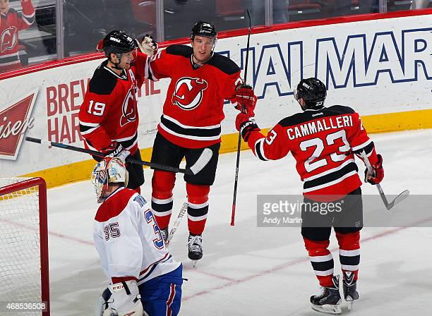 Stefan Matteau of the New Jersey Devils is congratulated by his teammates after scoring his first goal of the season against the Montreal Canadiens...