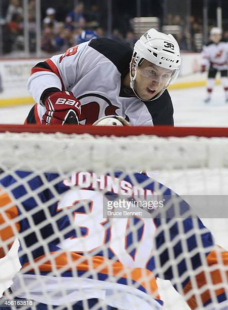 Stefan Matteau of the New Jersey Devils is stopped by Chad Johnson of the New York Islanders during the second period at the Barclays Center on...