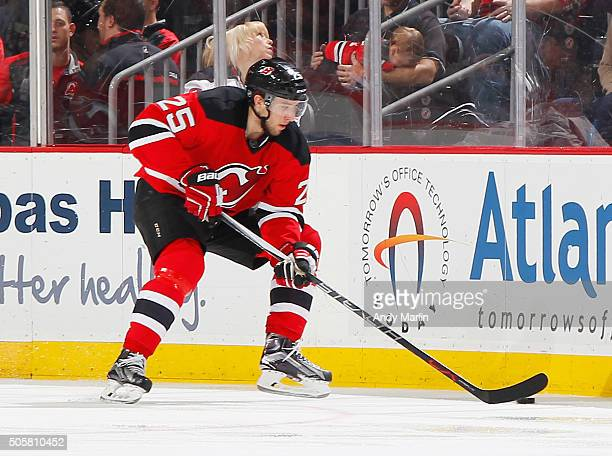 Stefan Matteau of the New Jersey Devils plays the puck during the game against the Boston Bruins at the Prudential Center on January 8 2016 in Newark...