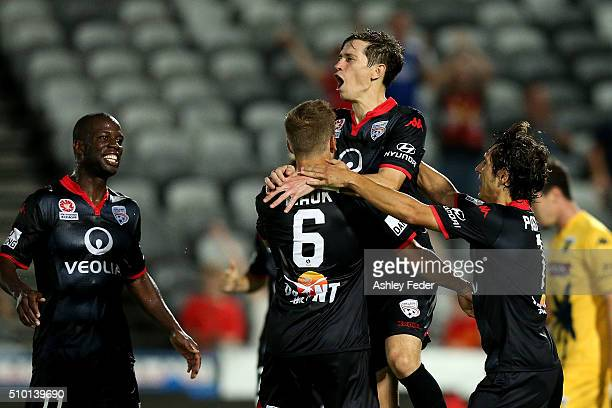 Stefan Mauk of Adelaide United celebrates his goal with Mariners players looking dejected in frame during the round 19 ALeague match between the...