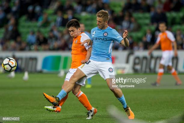Stefan Mauk of Melbourne City and Joe Caletti of the Brisbane Roar contes the ball during Round 1 of the Hyundai ALeague Series between Brisbane Roar...