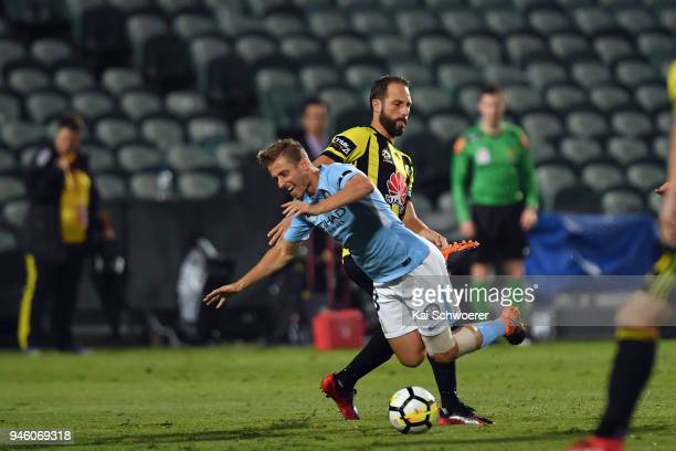Stefan Mauk of Melbourne City is tackled by Andrew Durante of the Phoenix during the round 27 ALeague match between the Wellington Phoenix and...