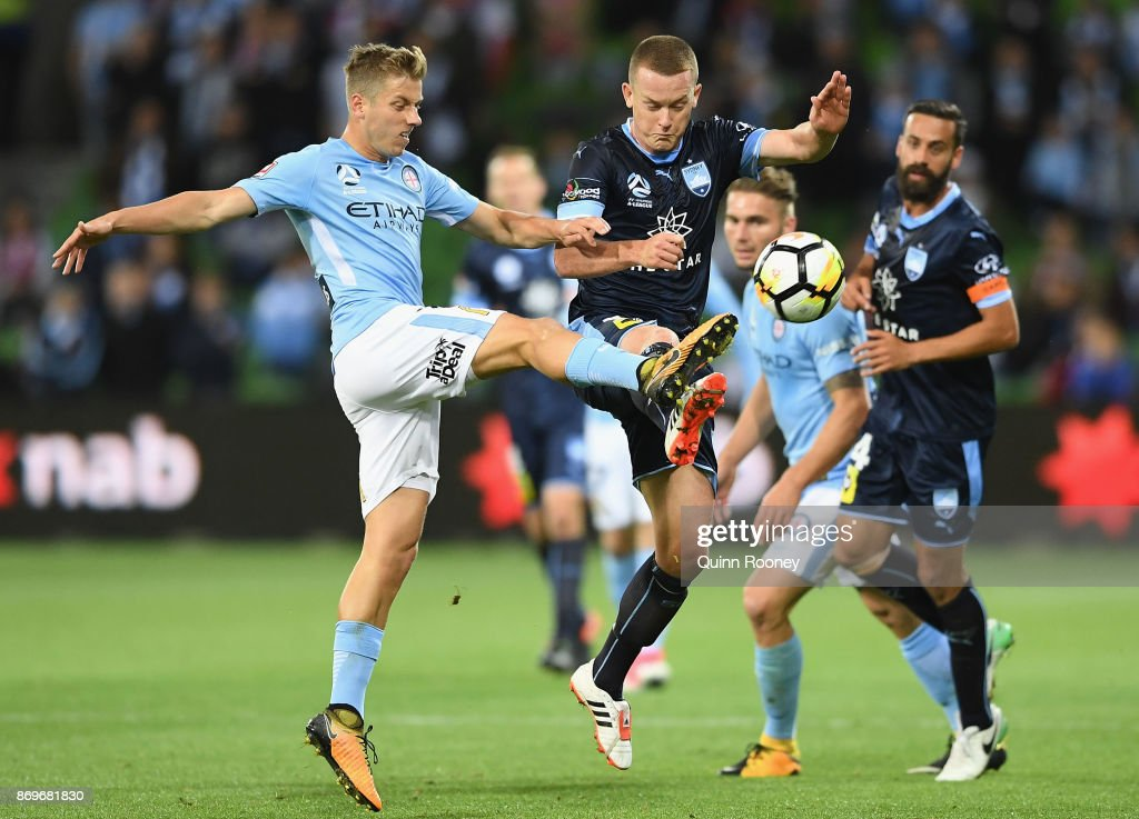 Stefan Mauk of the City and Brandon O'Neill of Sydney FC compete for the ball during the round five A-League match between Melbourne City FC and Sydney FC at AAMI Park on November 3, 2017 in Melbourne, Australia.