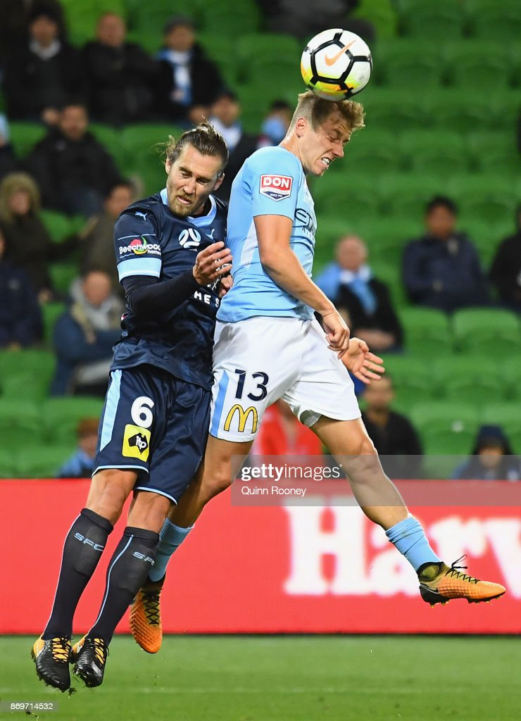 Stefan Mauk of the City heads the ball infront of Josh Brillante of Sydney FC during the round five A-League match between Melbourne City FC and Sydney FC at AAMI Park on November 3, 2017 in Melbourne, Australia.