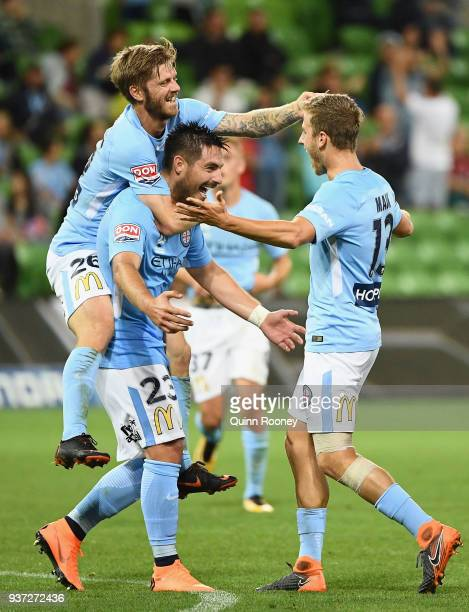 Stefan Mauk of the City is congratulated by Luke Brattan and Bruno Fornaroli after scoring a goal during the round 24 ALeague match between Melbourne...
