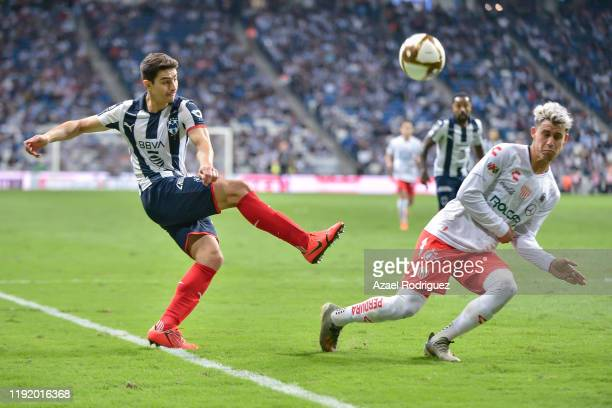 Stefan Medina #33 of Monterrey kicks the ball towards Alexis Peña #4 of Necaxa during the Semifinals first leg match between Monterrey and Necaxa as...