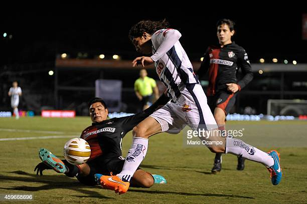 Stefan Medina of Monterrey drives the ball during a quarterfinal first leg match between Monterrey and Atlas as part of the Apertura 2014 Liga MX at...