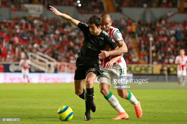 Stefan Medina of Monterrey fights for the ball with Carlos Gonzalez of Necaxa during the 8th round match between Necaxa and Monterrey as part of the...