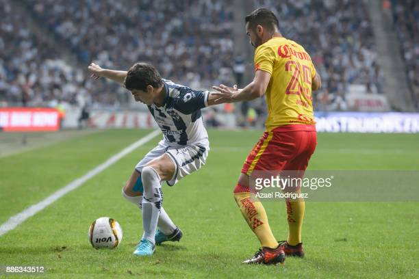 Stefan Medina of Monterrey fights for the ball with Mario Osuna of Morelia during the semifinal second leg match between Monterrey and Morelia as...