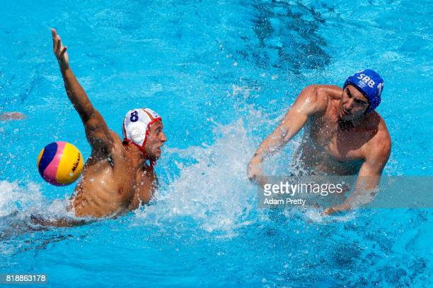 Stefan Mitorvic of Serbia shoots past Albert Espanol Lifante of Spain during the Men's Water Polo Group C preliminary match between Spain and Serbia...