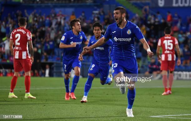 Stefan Mitrovic of Getafe celebrates after scoring their sides first goal during the La Liga Santander match between Getafe CF and Club Atletico de...