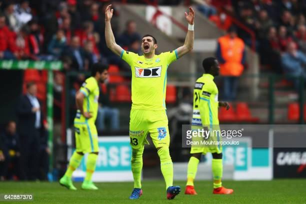 Stefan Mitrovic of KAA Gent celebrates scoring his teams first goal of the game during the Belgian Jupiler Pro League match between Royal Standard de...