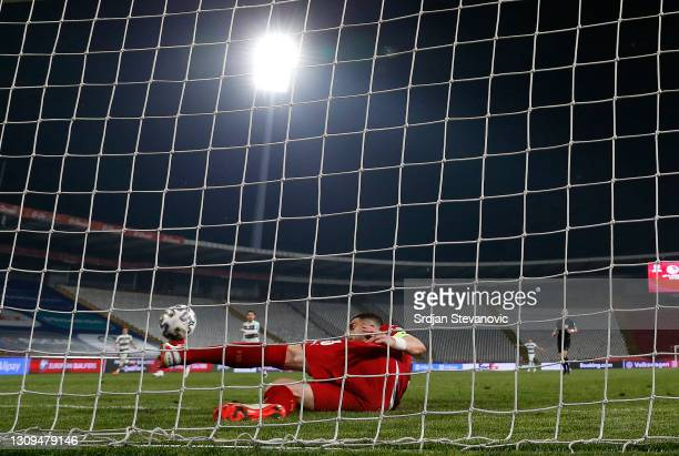 Stefan Mitrovic of Serbia clears the ball off the line during the FIFA World Cup 2022 Qatar qualifying match between Serbia and Portugal at FK Crvena...