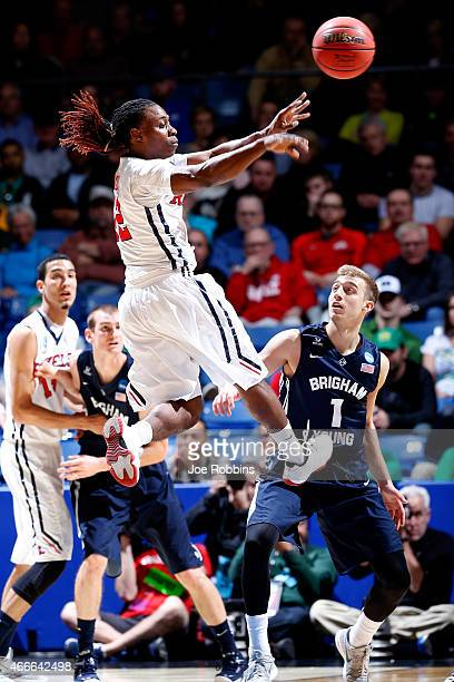 Stefan Moody of the Mississippi Rebels passes the ball against the Brigham Young Cougars during the first round of the 2015 NCAA Men's Basketball...
