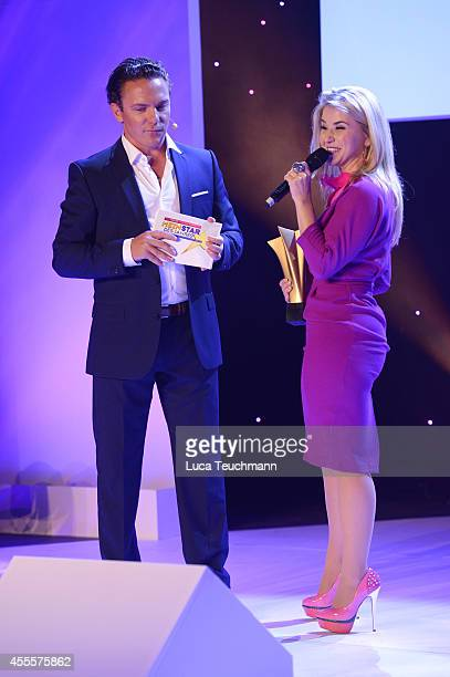 Stefan Mross and Beatrice Egli attend the 'Mein Star des Jahres 2014' awards at Kehrwieder Theater on September 16 2014 in Hamburg Germany