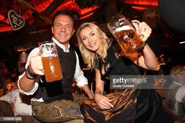 Stefan Mross and his girlfriend AnnaCarina Woitschack during the 'Almauftrieb' as part of the Oktoberfest 2018 at Kaefer Tent at Theresienwiese on...