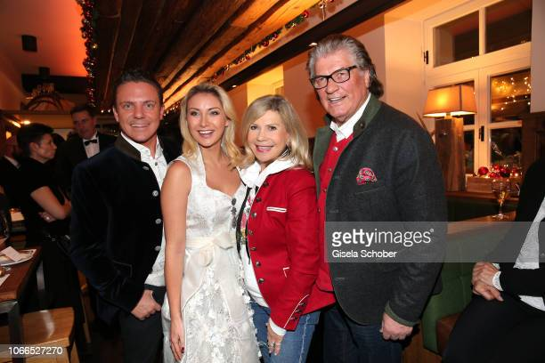 Stefan Mross and his girlfriend AnnaCarina Woitschack Marianne Hartl and her husband Michael Hartl during the Christmas Charity Dinner hosted by...