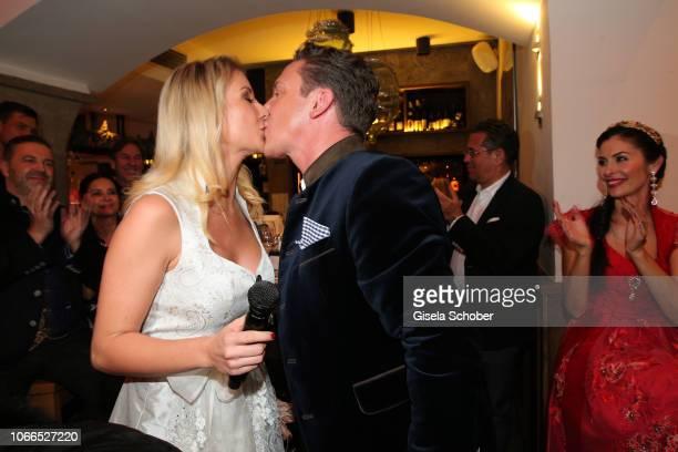 Stefan Mross and his girlfriend AnnaCarina Woitschack sing during the Christmas Charity Dinner hosted by StefanMross AnnaCarinaWoitschack and...
