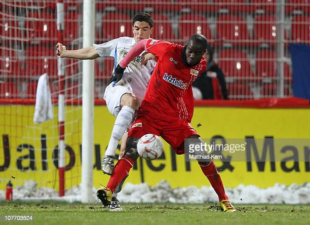 Stefan Mueller of Karlsruhe battles for the ball with John Jairo Mosquera of Berlin during the Second Bundesliga match between 1.FC Union Berlin and...