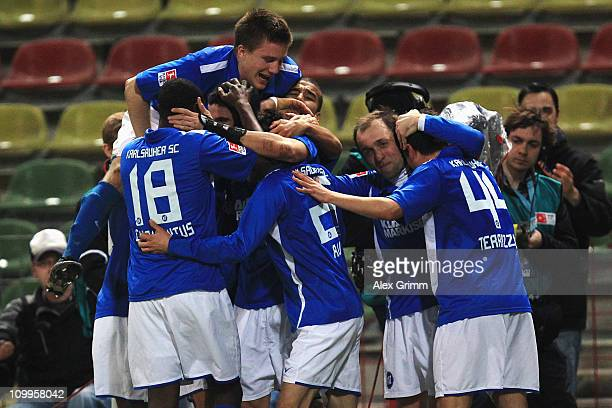 Stefan Mueller of Karlsruhe celebrates his team's third goal with team mates during the Second Bundesliga match between Karlsruher SC and MSV...