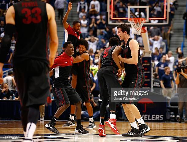 Stefan Nastic and Chasson Randle of the Stanford Cardinal celebrate their 5351 win against the Connecticut Huskies during the game at XL Center on...