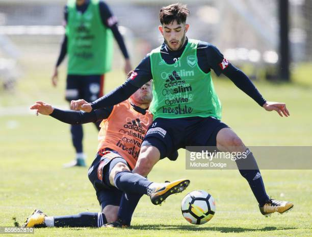 Stefan Nigro and Christian Theoharous compete for the ball during a Melbourne Victory ALeague training session at Gosch's Paddock on October 10 2017...