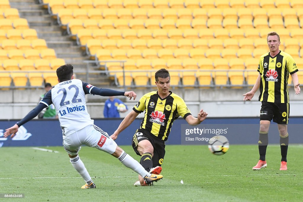 Stefan Nigro of Melbourne Victory tackles Andrija Kaluderovic of the Wellington Phoenix during the round nine A-League match between the Wellington Phoenix and the Melbourne Victory at Westpac Stadium on December 3, 2017 in Wellington, New Zealand.