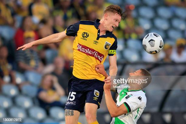 Stefan Nigro of the Mariners competes for the ball with Dylan Pierias of United during the round 7 A-League match between the Central Coast Mariners...