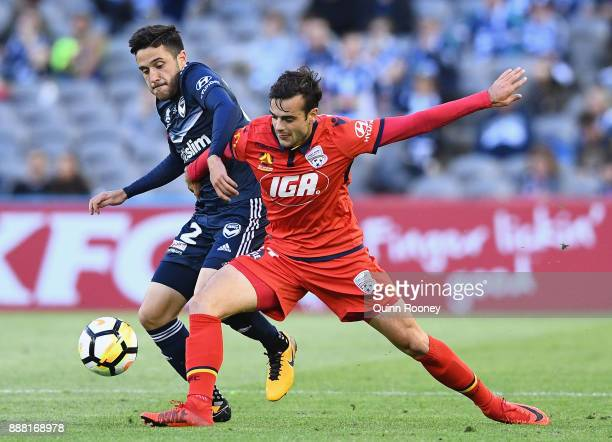 Stefan Nigro of the Victory and Nikola Mileusnic of Adelaide United compete for the ball during the round 10 ALeague match between the Melbourne...
