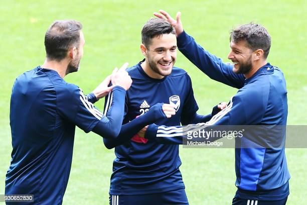 Stefan Nigro of the Victory is hugged by teammates during a Melbourne Victory Training Session at AAMI Park on March 12 2018 in Melbourne Australia
