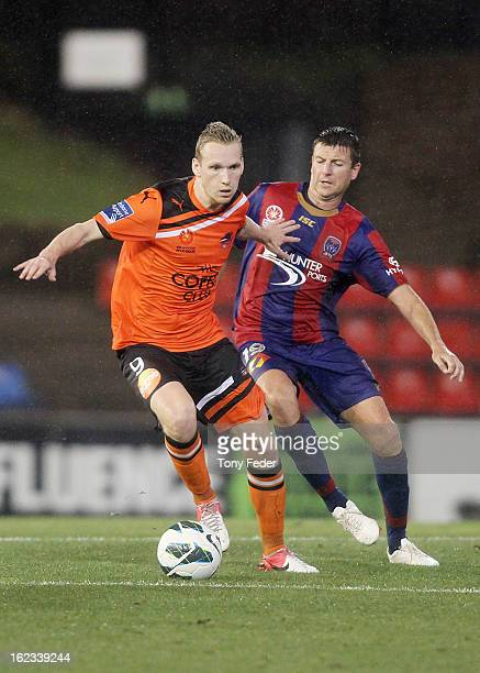 Stefan Nijland of the Brisbane Roar controls the ball against Michael Bridges of the Newcastle Jets during the round 22 ALeague match between the...