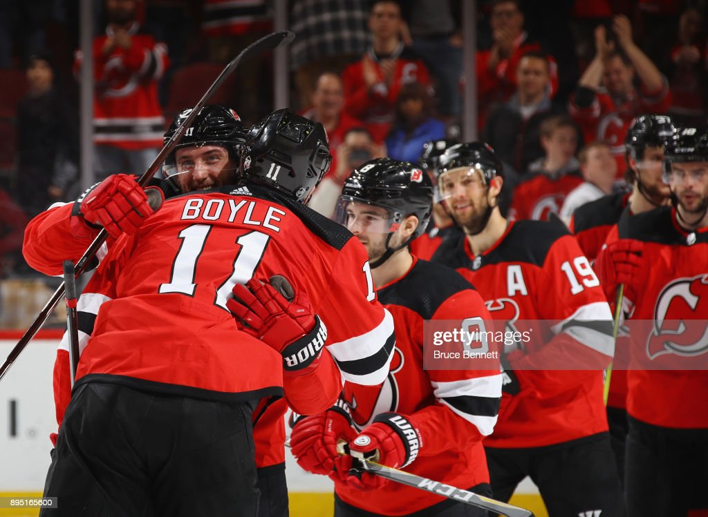 Stefan Noesen #23 and Brian Boyle #11 of the New Jersey Devils celebrate a 5-3 victory against the Anaheim Ducks at the Prudential Center on December 18, 2017 in Newark, New Jersey.