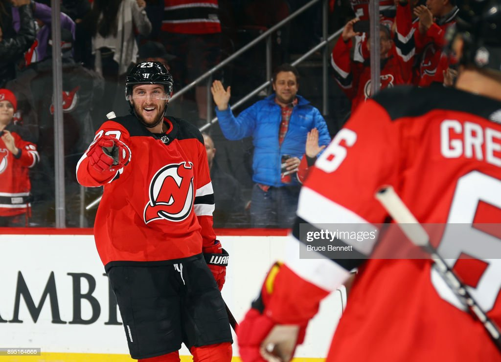 Stefan Noesen #23 of the New Jersey Devils celebrates his empty net goal and points to Brian Boyle #11 who assisted on it against the Anaheim Ducks at the Prudential Center on December 18, 2017 in Newark, New Jersey. The Devils defeated the Ducks 5-3.