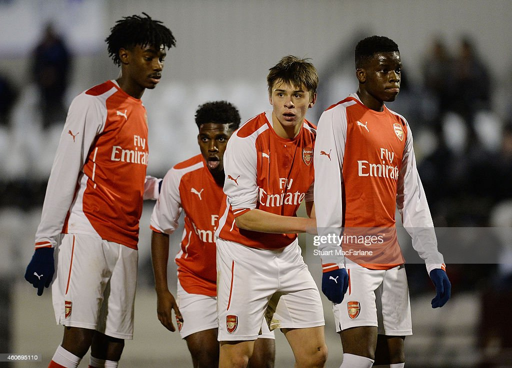 Stefan O'Connor, Aaron Eyoma, George Dobson and Stephy Mavididi of Arsenal during the FA Youth Cup 3rd Round match between Arsenal and Reading at Meadow Park on December 19, 2014 in Borehamwood, England.