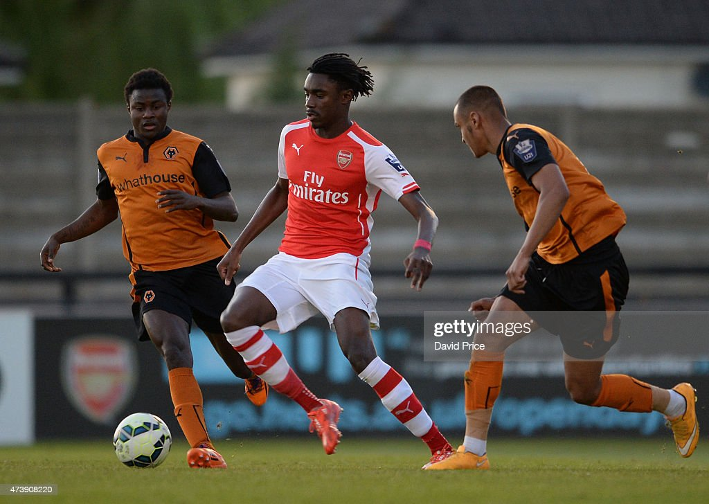 Stefan O'Connor of Arsenal passes the ball away from Bright Enobakhare and Connor Hunte of Wolves during the match between Arsenal U21s and Wolverhampton Wanderers U21s at Meadow Park on May 18, 2015 in Borehamwood, England.