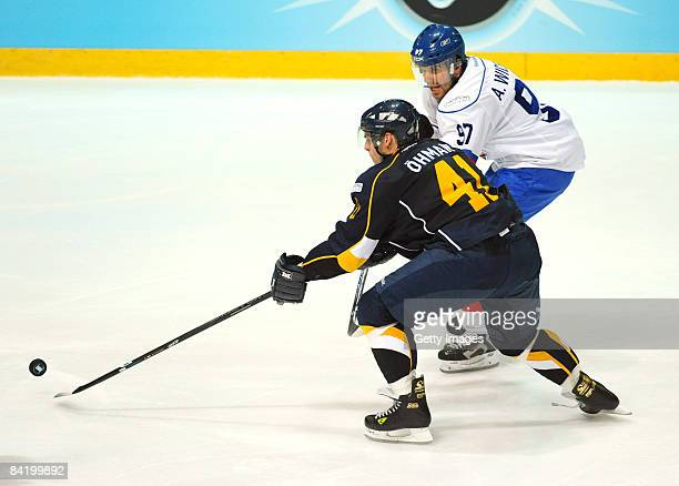 Stefan Ohman of Espoo Blues and Adrian Wichser of ZCS compete during the IIHF Champions Hockey League semi-final match between Espoo Blues and ZSC...