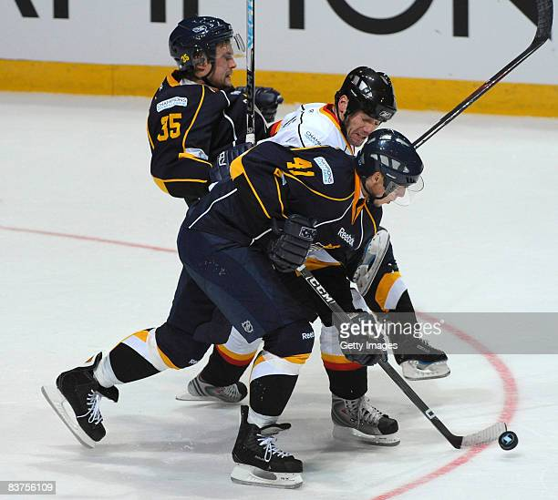 Stefan Ohman of Espoo Blues and Petri Kokko of Espoo Blues fight for the puck during the IIHF Champions Hockey League match between Espoo Blues and...