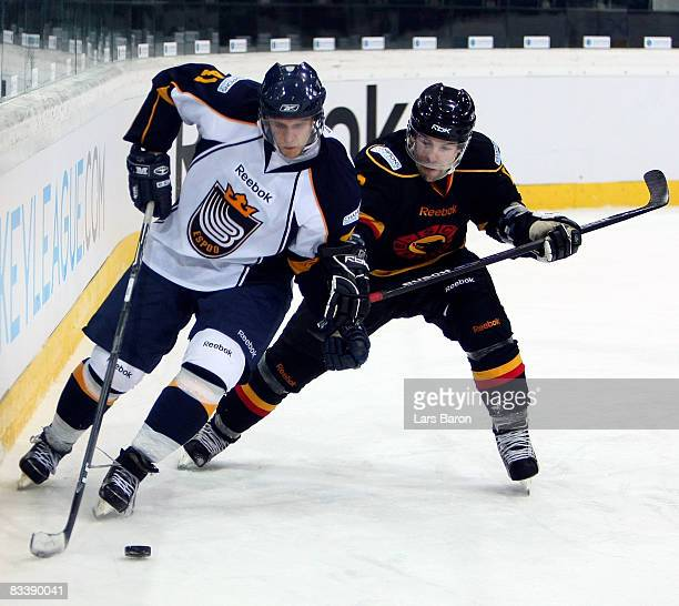 Stefan Ohman of Espoo competes with Martin Pluss of Bern during the IIHF Champions Hockey League match between SC Bern and Espoo Blues at the...