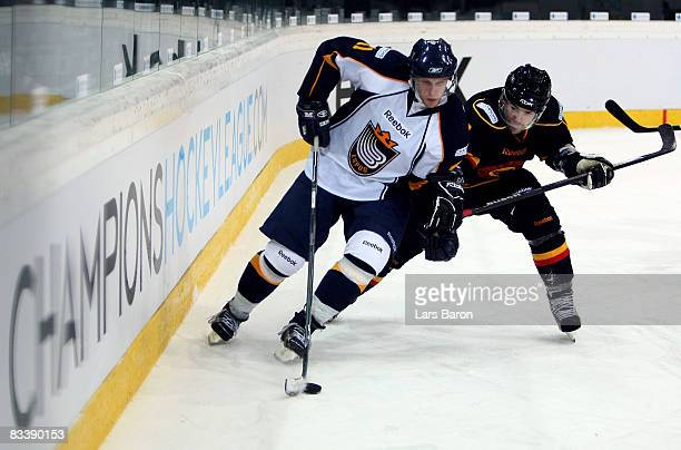 Stefan Ohman of Espoo in action with Martin Pluss of Bern during the IIHF Champions Hockey League match between SC Bern and Espoo Blues at the...